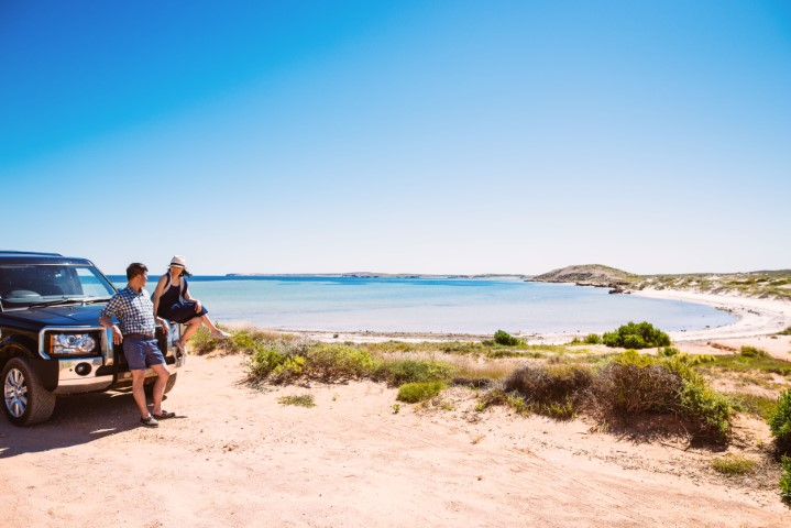Couple with 4wd parked at Whalebone Bay campsite within the Shark Bay World Heritage Area.