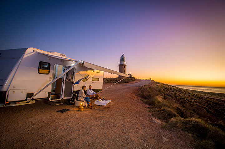 Couple with Caravan at sunset at Vlamingh Head Lighthouse